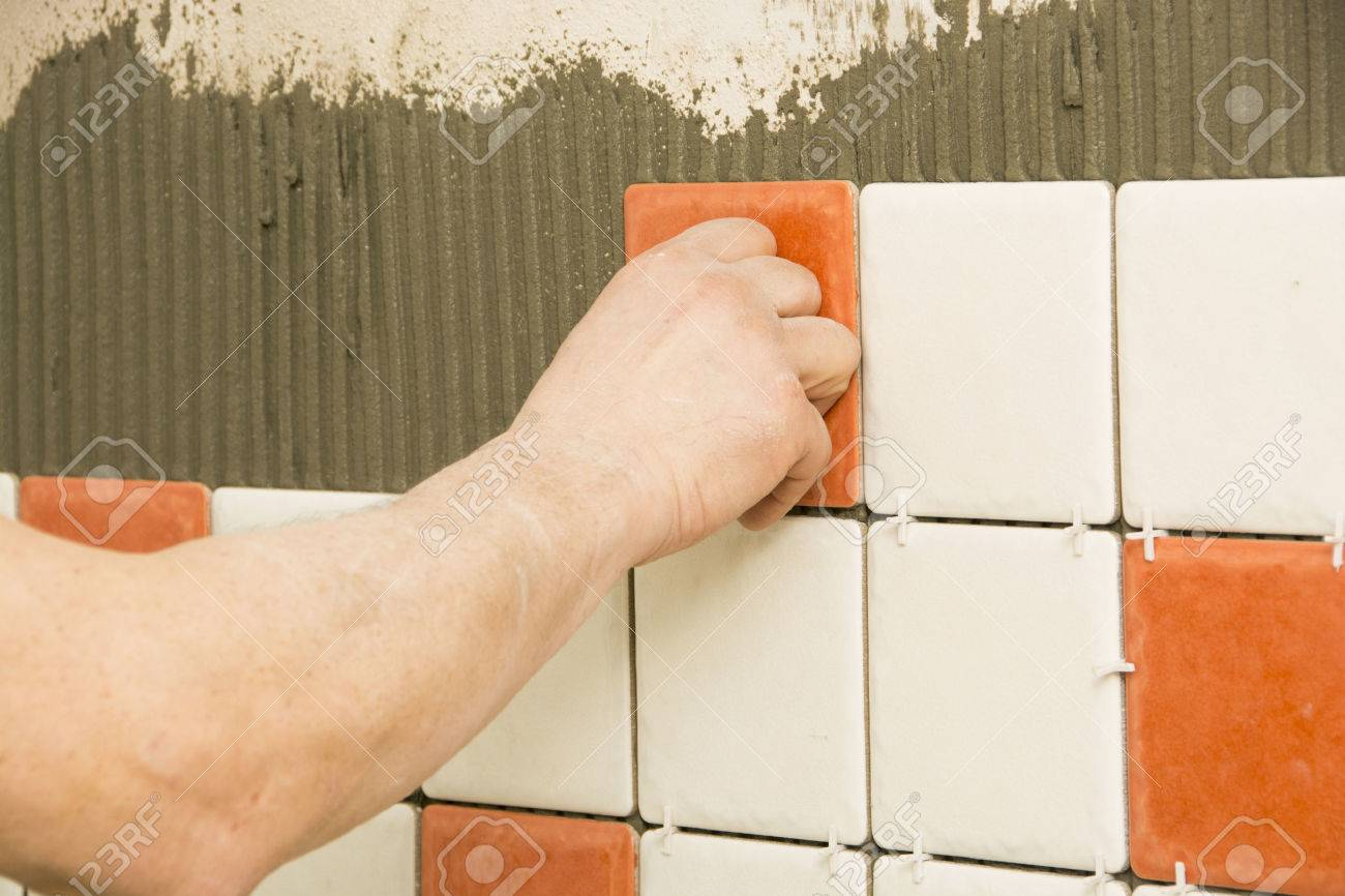 Man Installing Ceramic Tile On A Wall Stock Photo, Picture And ...