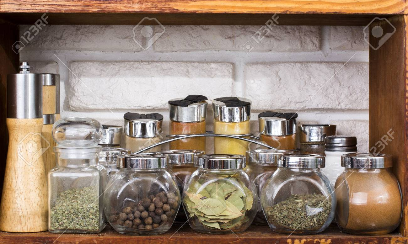 Set of various spices in jars on k itchen shelf - 60069972