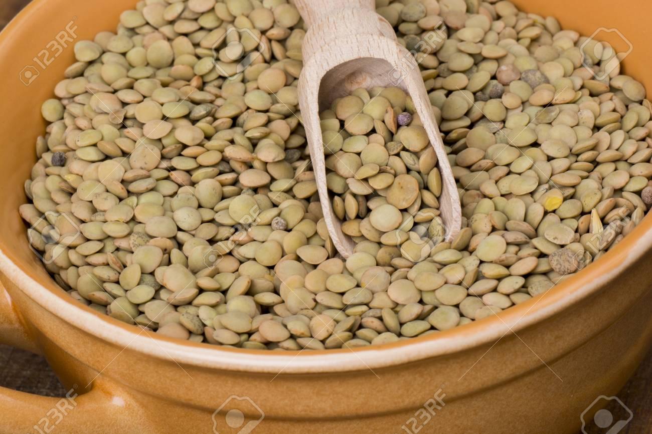 Lentil in bowl on wooden table - 60069990