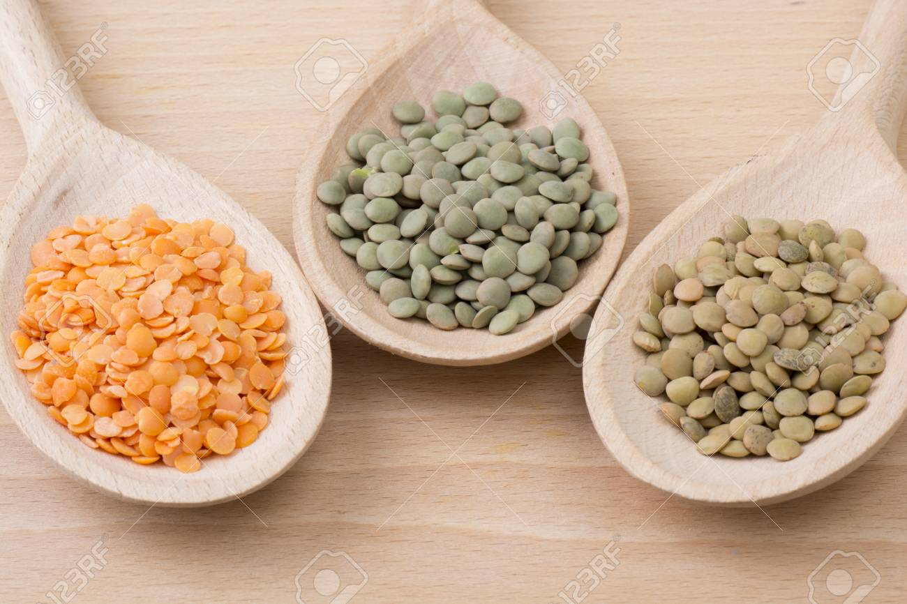 Three kinds of lentil on spoons - 60070002