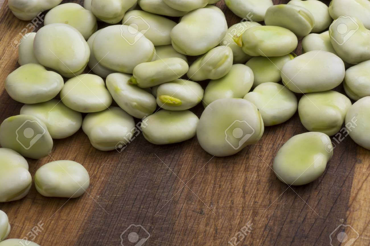 Fresh broad beans on wooden board - 60747238