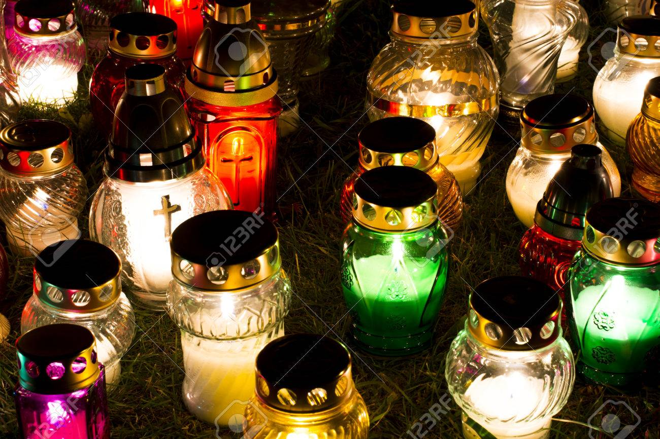 Candles Burning At a Cemetery During All Saints Day. - 66596506