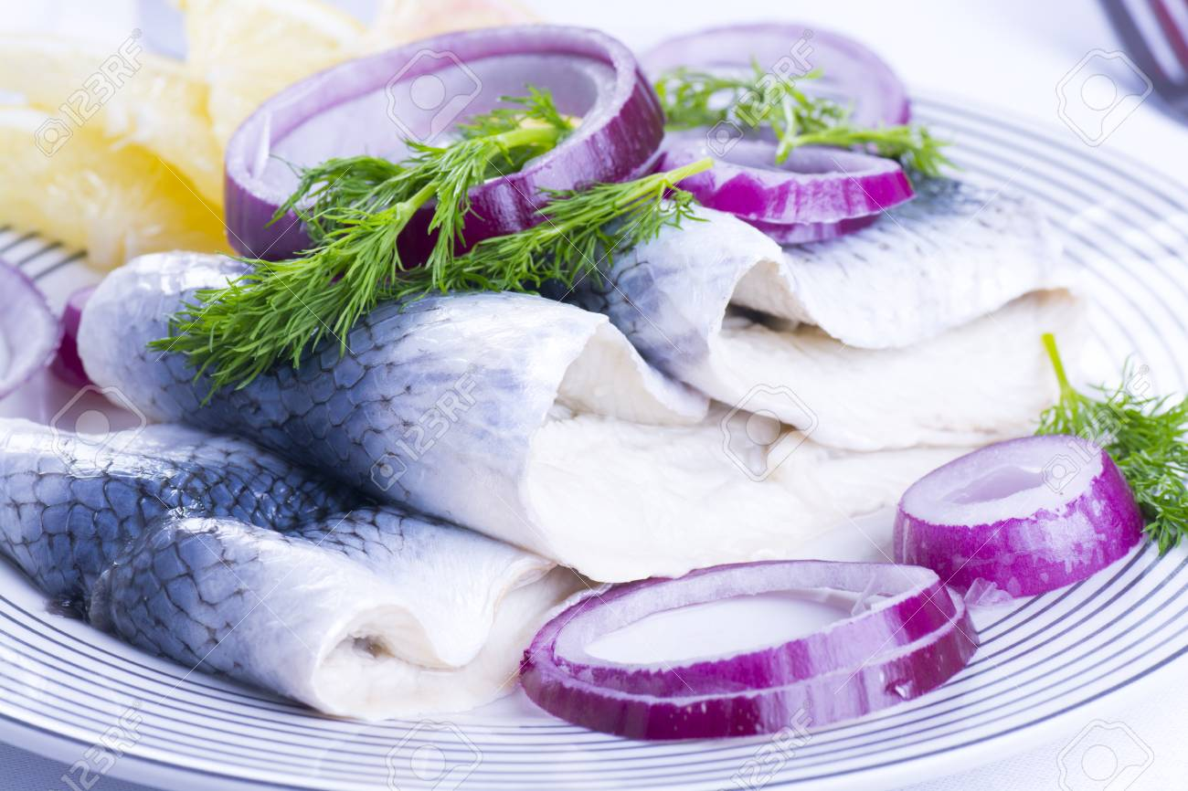 Herrings for Christmas on a plate - 67417225