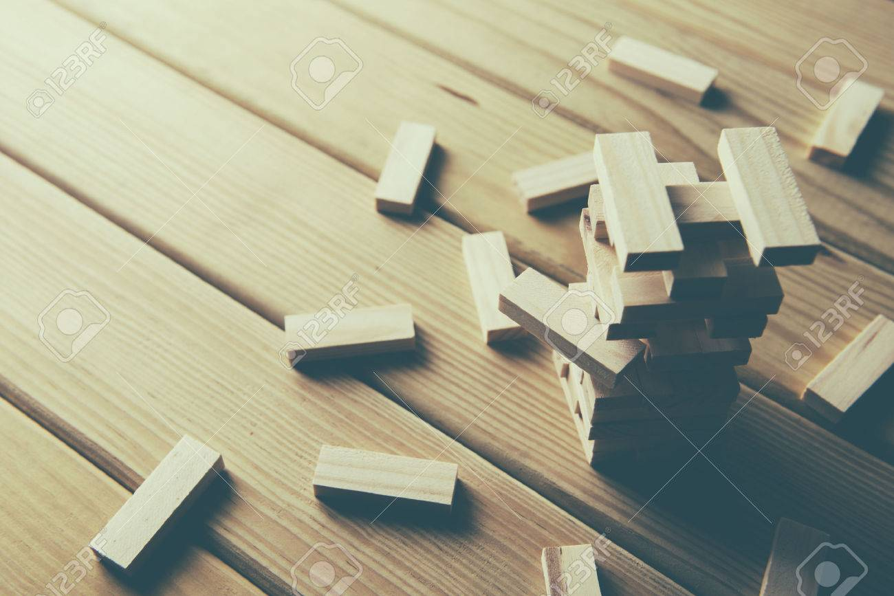 Jenga, Wood blocks stack game on wood background Banque d'images - 55512939