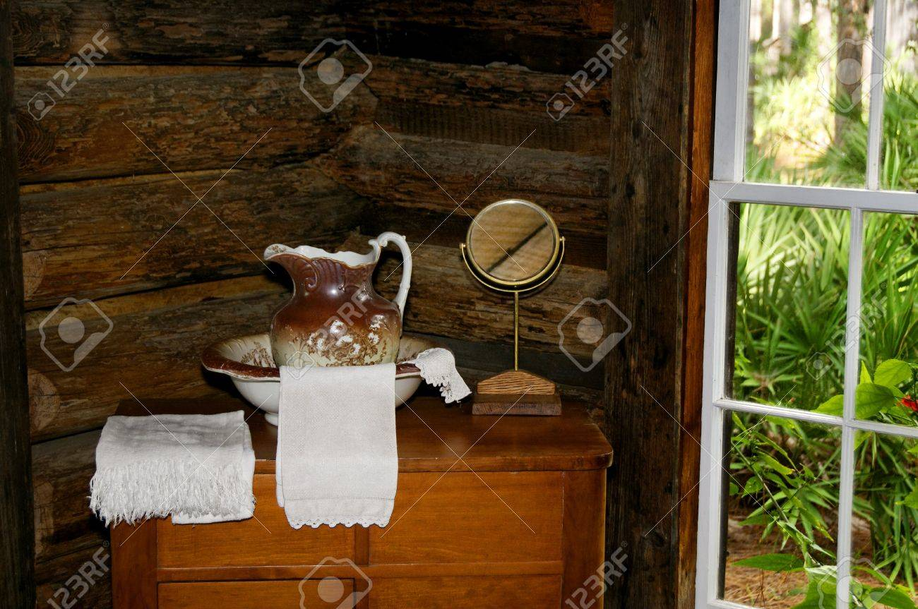 Antique Wash Basin And Dresser With Towels And A Mirror Stock Photo