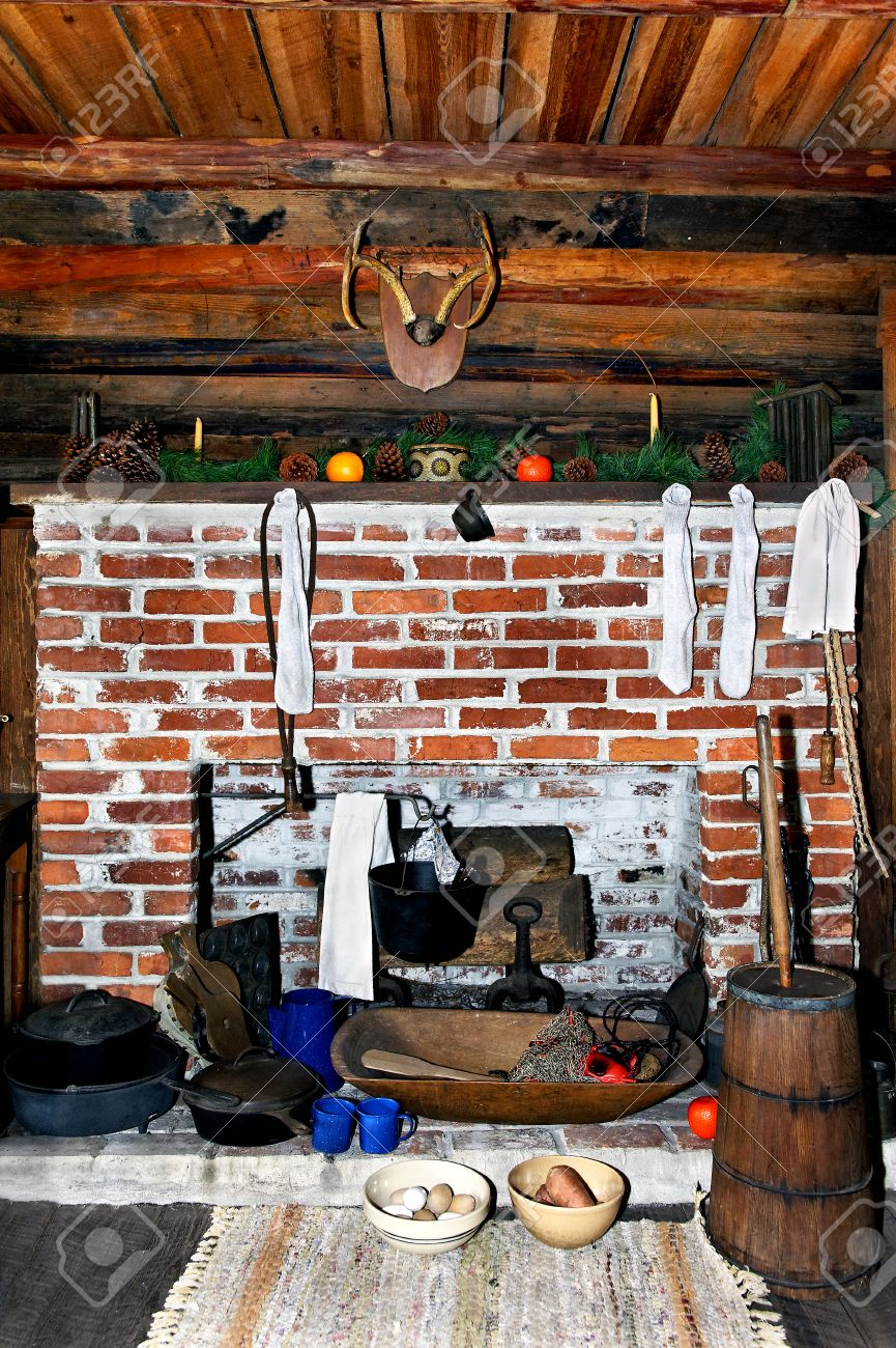 old log cabin fireplace at christmas time with stockings stock