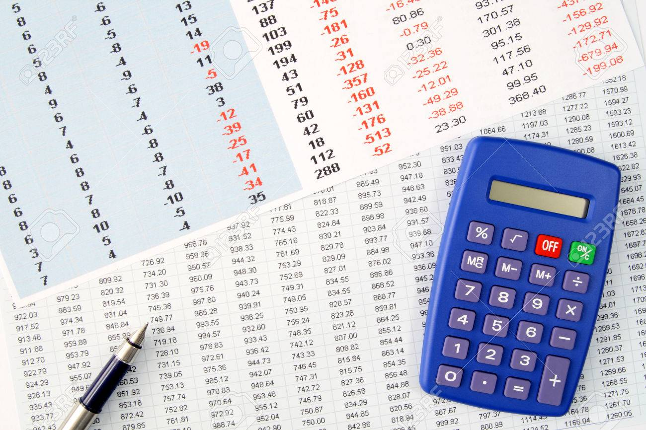 Reviewing financial numbers on a spreadsheet. Stock Photo - 1463410