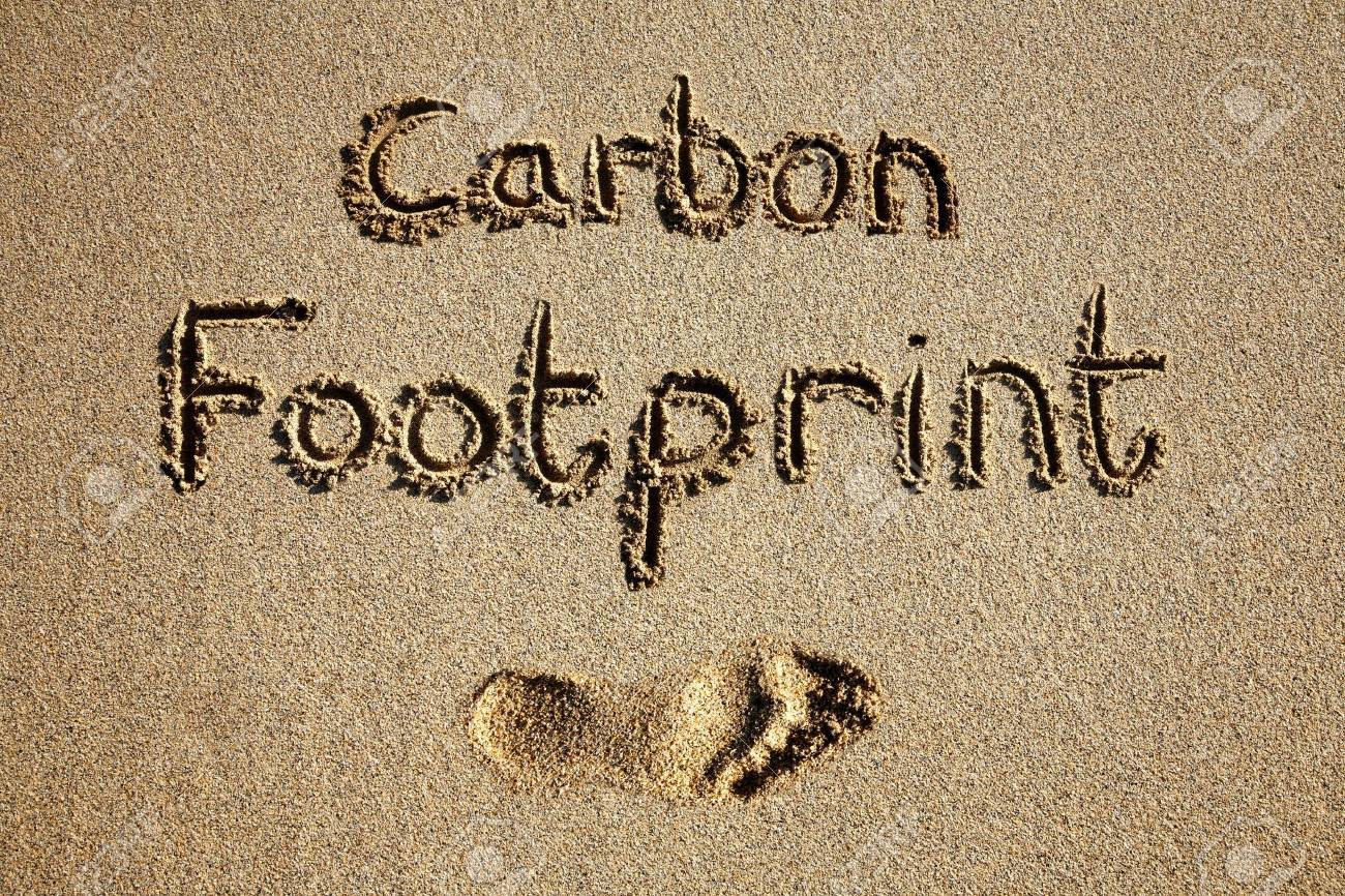 Carbon footprint written in sand on a beach. Stock Photo - 2586341