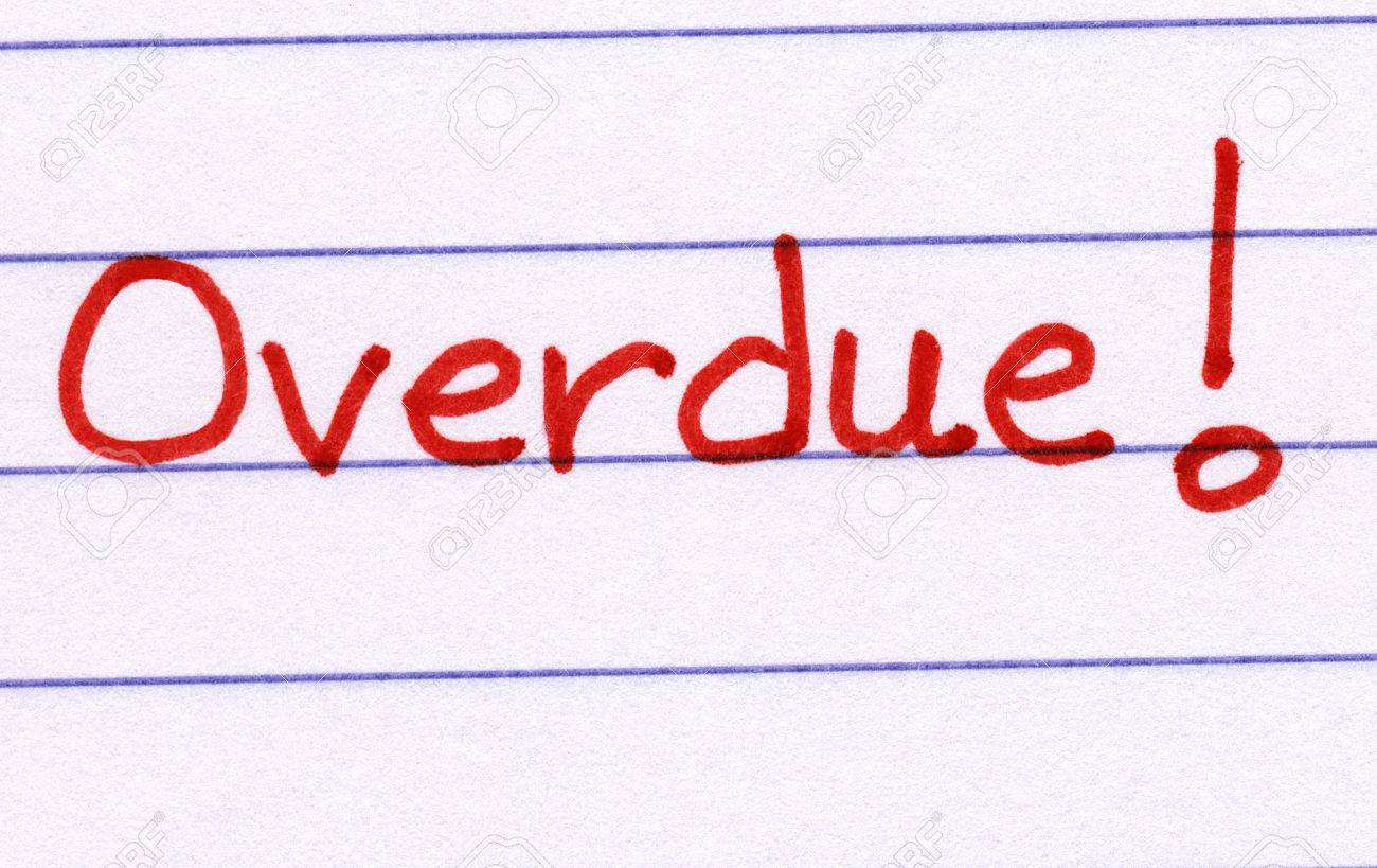 overdue written in red ink on white paper stock photo picture