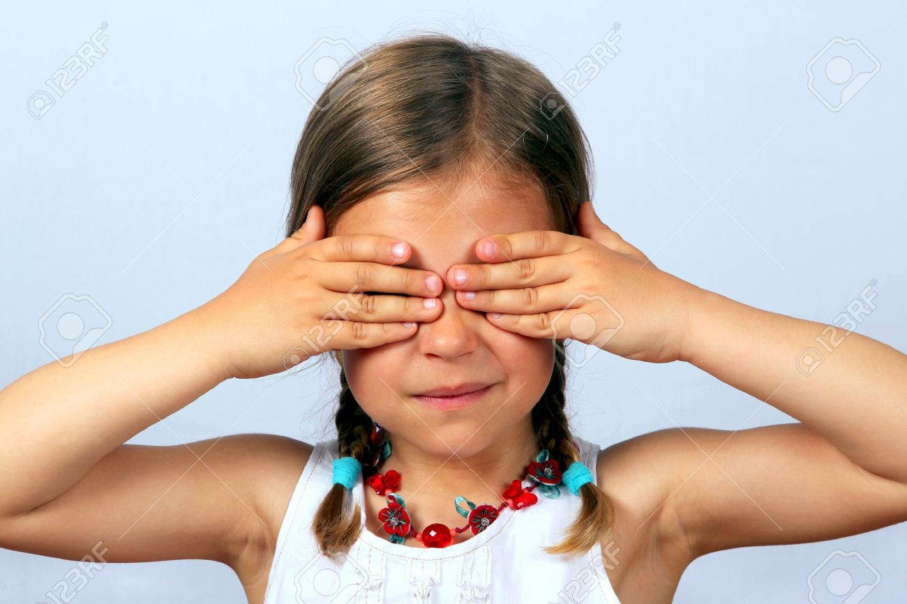 Little girl with her hands covering her eyes Stock Photo - 6990588