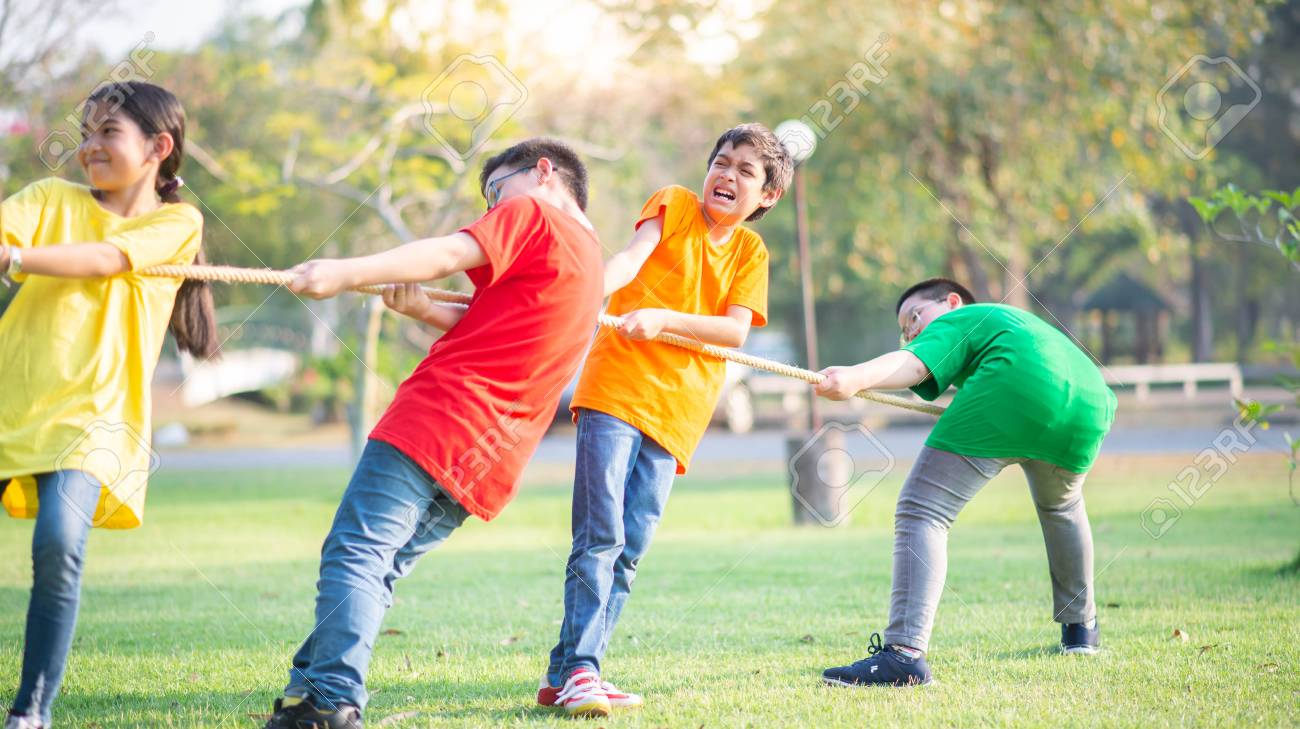 Asian students girls and boys play tug of war - 120135652