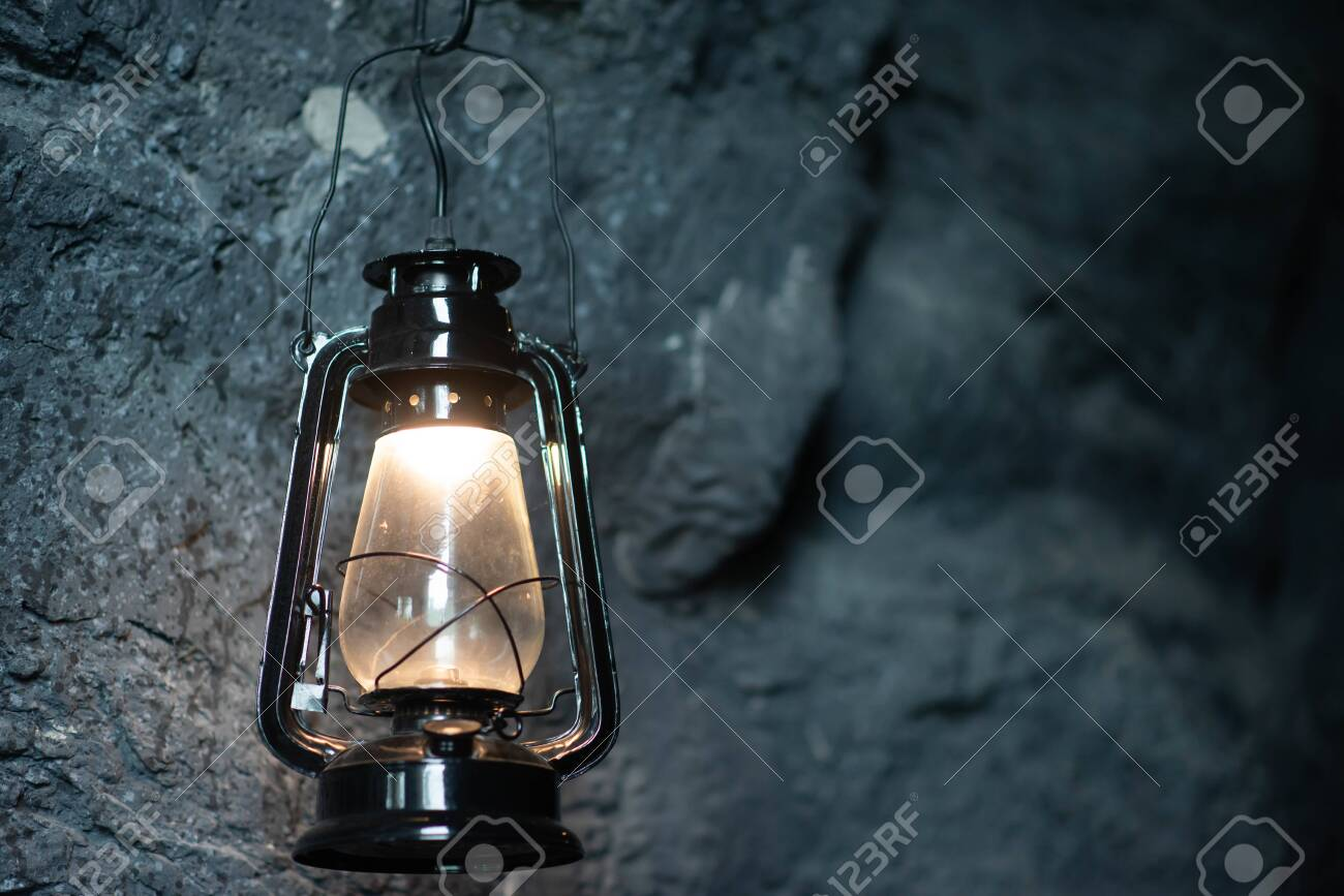 Oil lamp hanging on the cave stone wall - 138159868