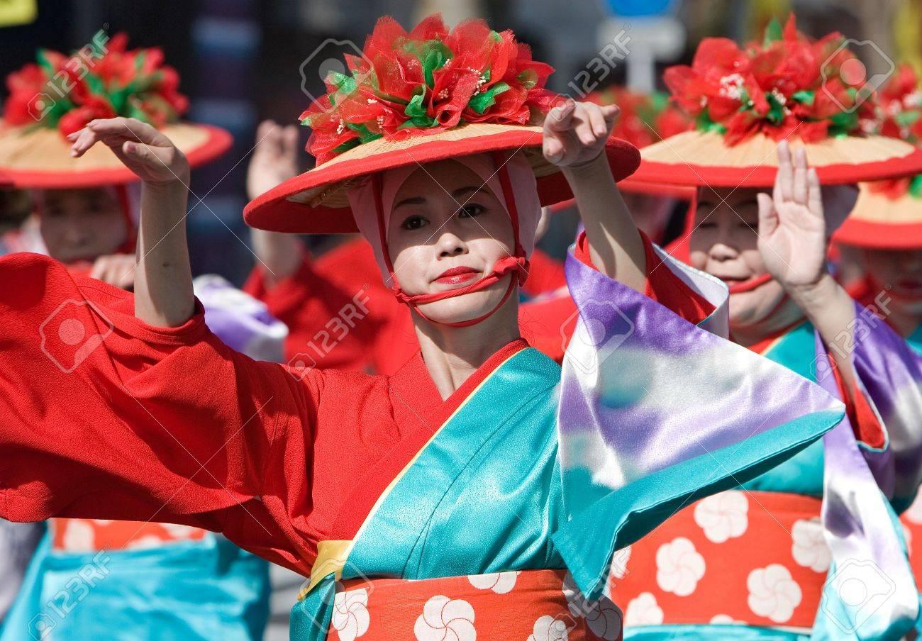 Kagoshima City, Japan, October 28, 2007. Women in yukata kimono dancing in symmetry during the Taniyama Furusato Matsuri dance festival. Stock Photo - 6935419