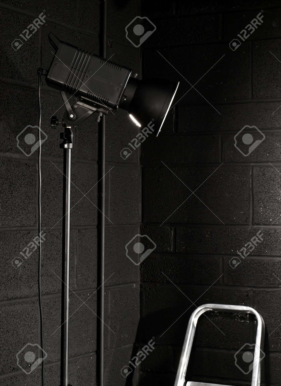 Photography studio light against a black brick wall background Stock Photo - 2973078