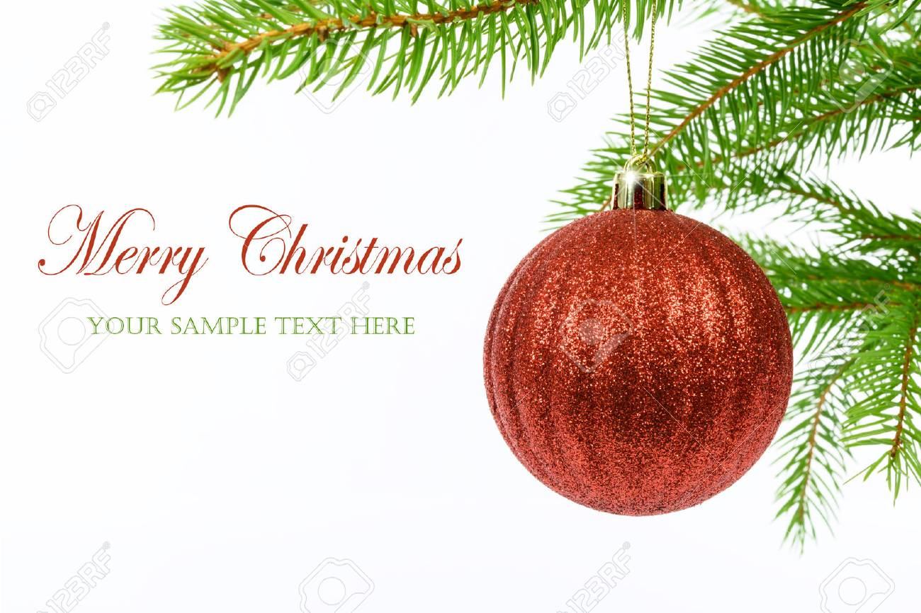 Shining red Christmas ball hanging from a branch of a Christmas tree isolated on a white background with copy space place (sample text). - 89329272