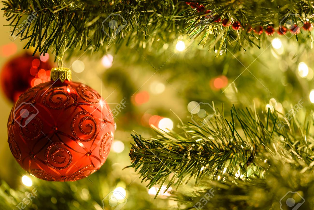 Good Beautiful Christmas Background   Red Baubles On A Background Of Blurred  Lights On A Christmas Tree