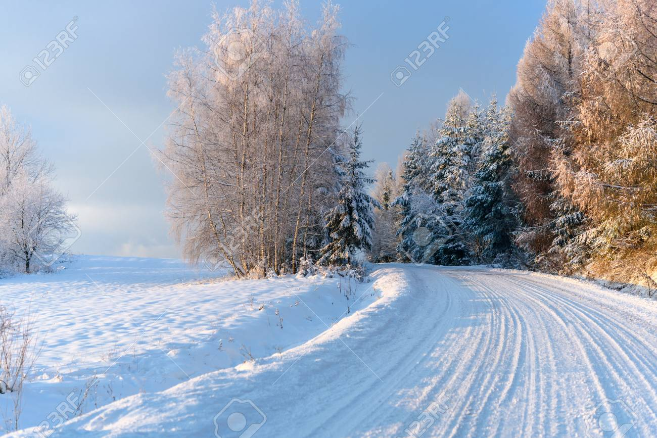 Winter landscape - snow covered mountain road on a cold and sunny morning - 91952564