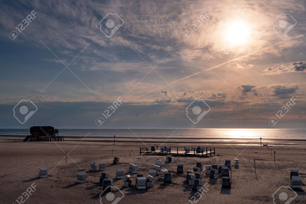 Stilt house on the beach of Sankt Peter-Ording in the sunset - 171101125