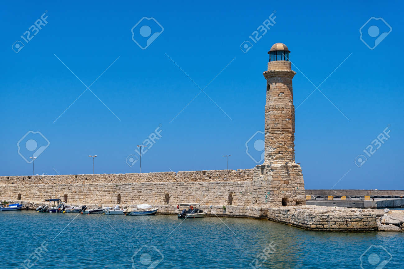 The historic lighthouse in the port of Rethymno on the Greek island of Crete - 173514008