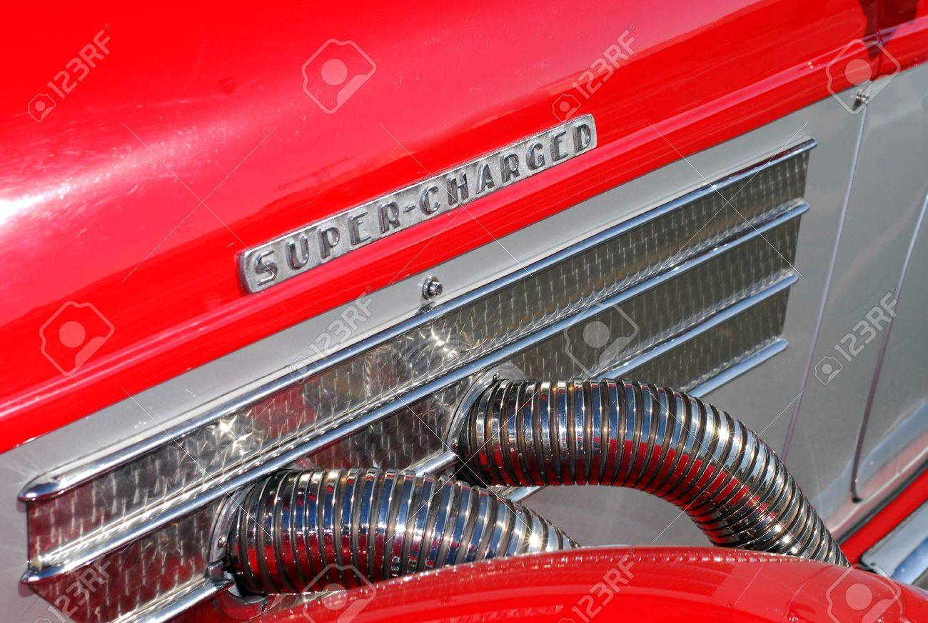 Side Exhaust Pipes On Classic Sports Car Stock Photo Picture And