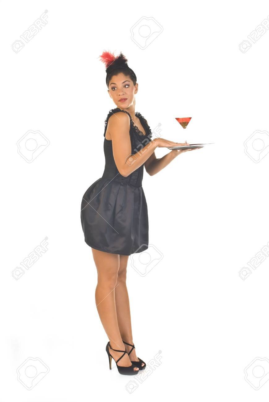 Cocktail Waitress In Lounge Ready To Serve A Drink Stock Photo ...