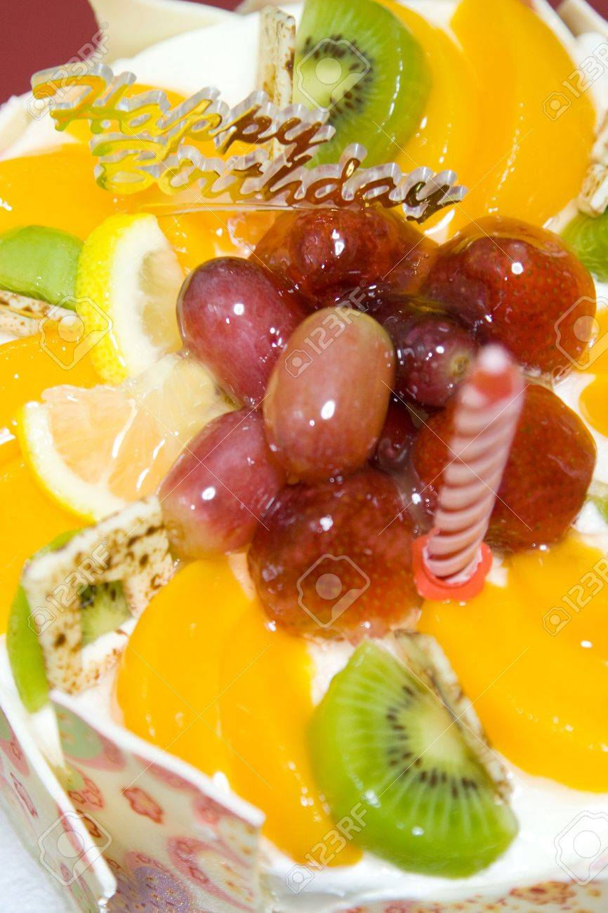 A Fruit Birthday Cake Adorned With White Chocolate Wafers Stock