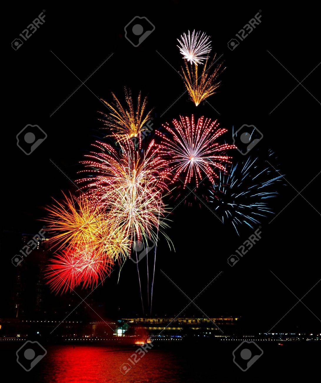 Colorful bursts of fireworks light up and decorate the night sky Stock Photo - 10025226