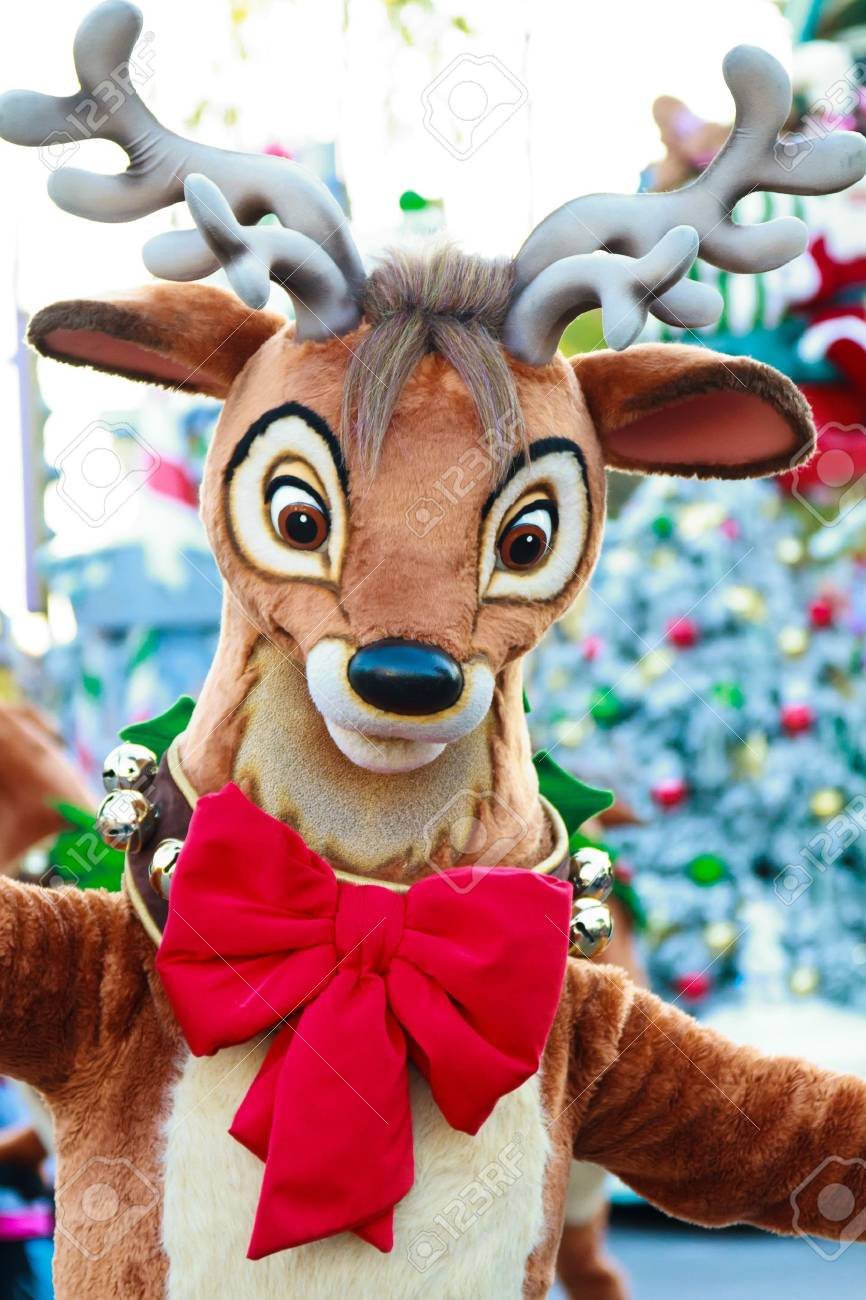 A festive reindeer requesting a hug from participants of the festivities Stock Photo - 11840912