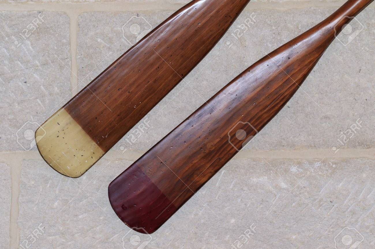 Pair of mounted, refurbished oars mounted on a brick wall. Stock Photo - 62914459
