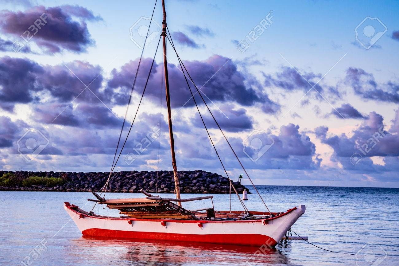 A micronesian tribal catamaran at anchor at the mouth of the bay. Stock Photo - 64068043