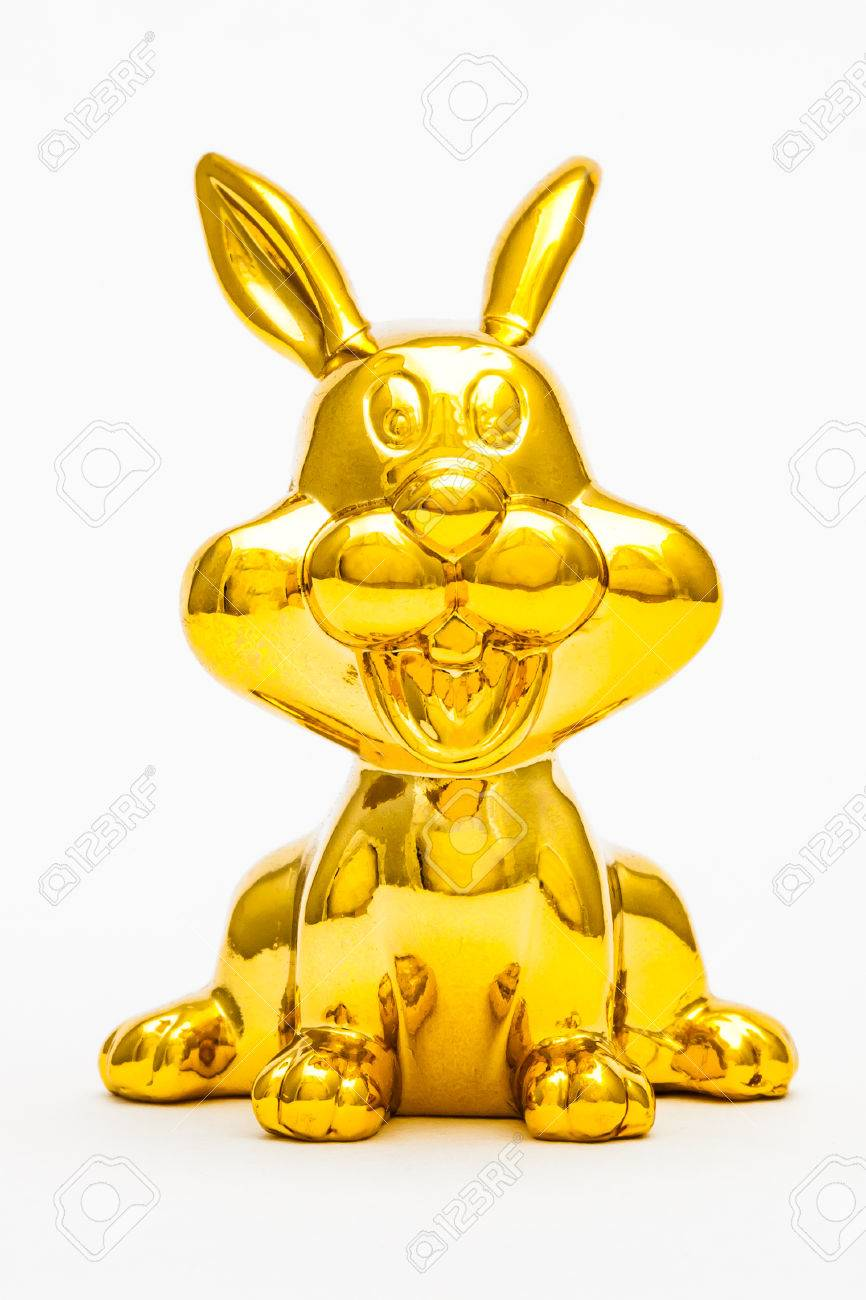 Golden figurine of the chinese zodiac sign of the rabbit. Stock Photo - 76996301