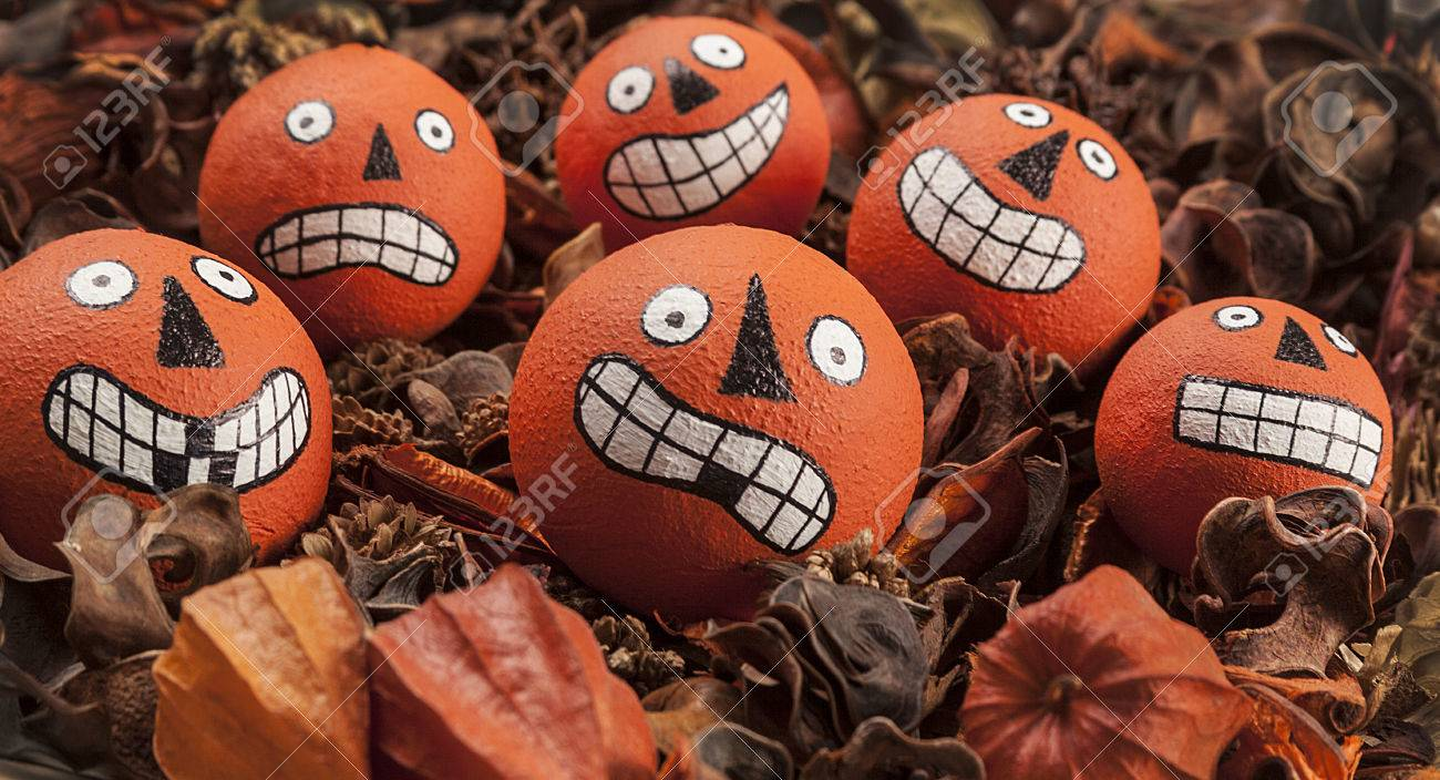 varied drawn halloween ping pong ball faces within potpourri stock photo 24172209 - Halloween Ping Pong Balls