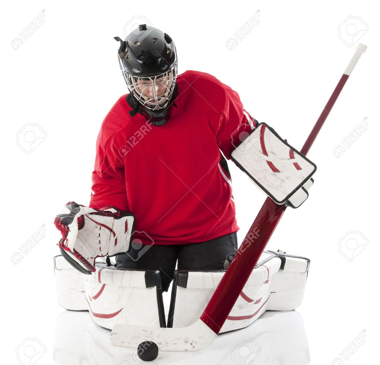 Ice Hockey Goalie Blocking A Puck In Butterfly Style Photo On