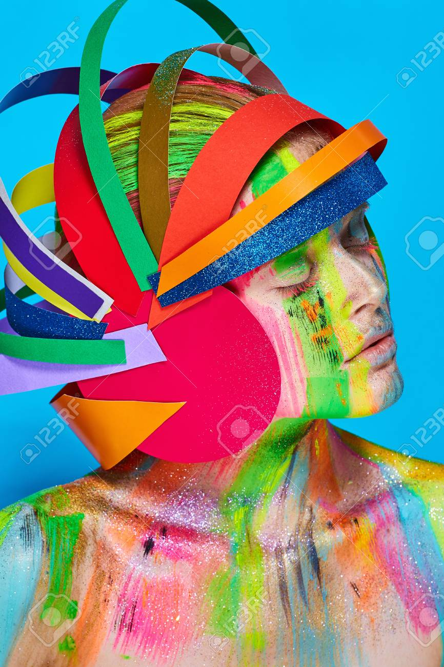 Model With Colorful Abstract Makeup In Multicolored Helmet On