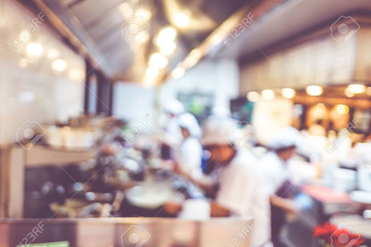 Crowded restaurant table - Crowded Restaurant Blurred Background Groups Of Chef Cooking In The Open Kitchen Customer