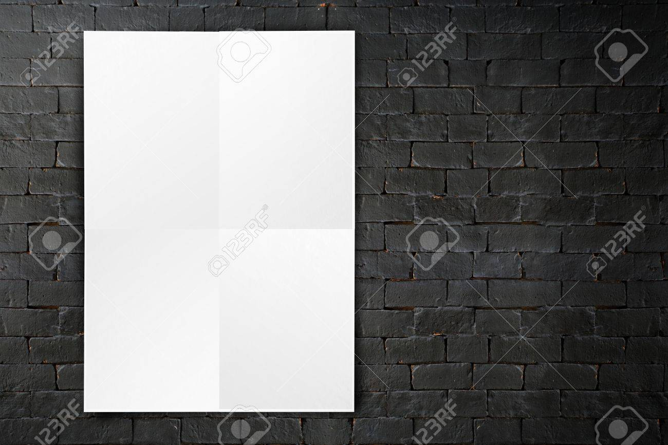 blank folded paper poster hanging on black brick wall template