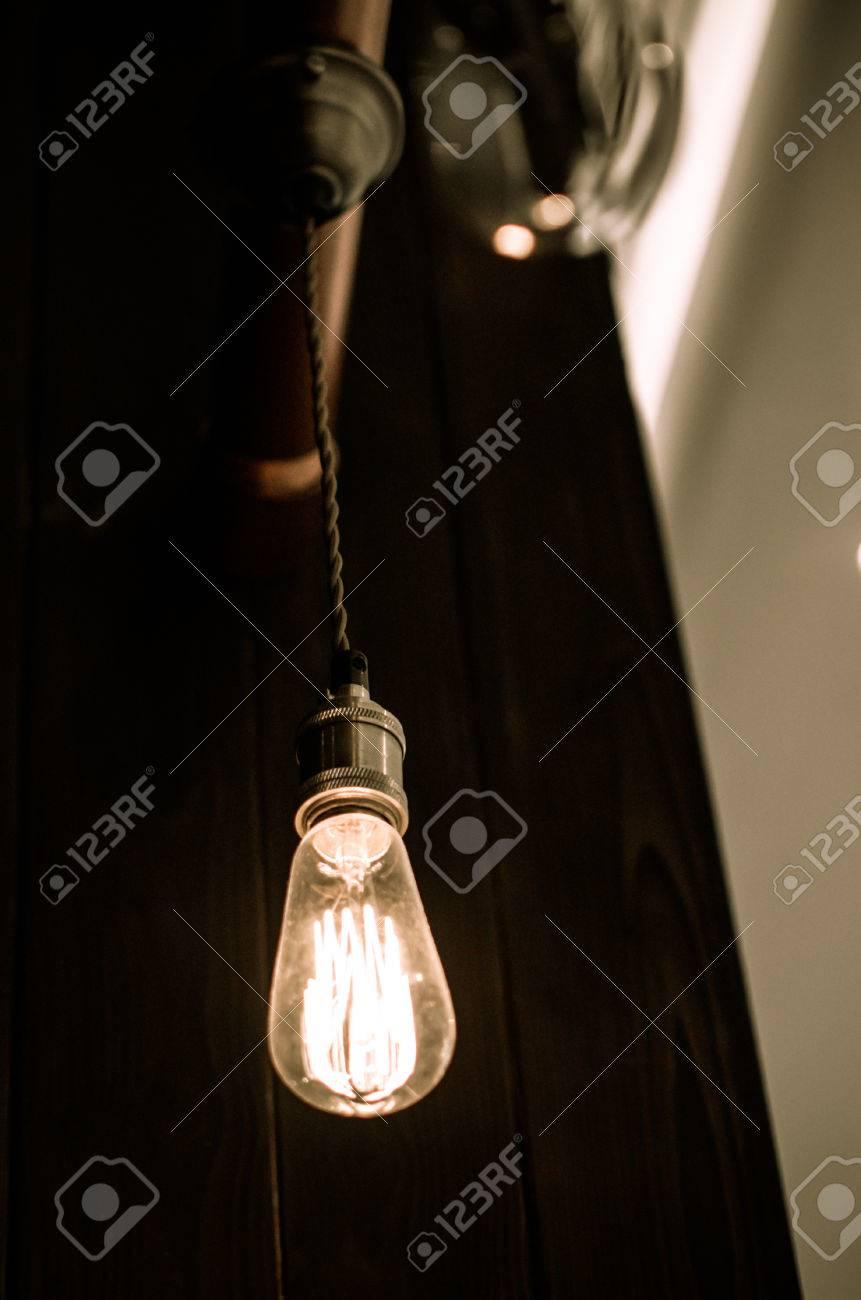Vintage light bulb hanging on ceiling stock photo picture and stock photo vintage light bulb hanging on ceiling aloadofball Gallery