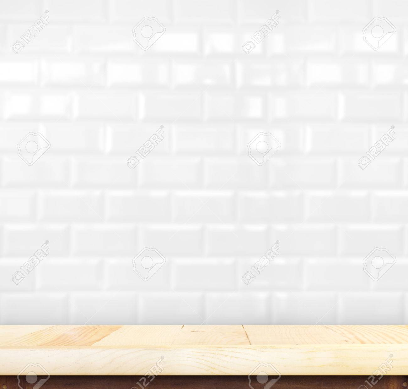 Empty wood table top with white ceramic tiles wallproduct display empty wood table top with white ceramic tiles wallproduct display template stock photo dailygadgetfo Gallery