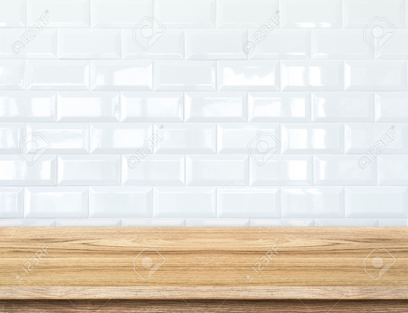Empty wood table and white ceramic tile brick wall in background empty wood table and white ceramic tile brick wall in backgroundmock up template for dailygadgetfo Gallery