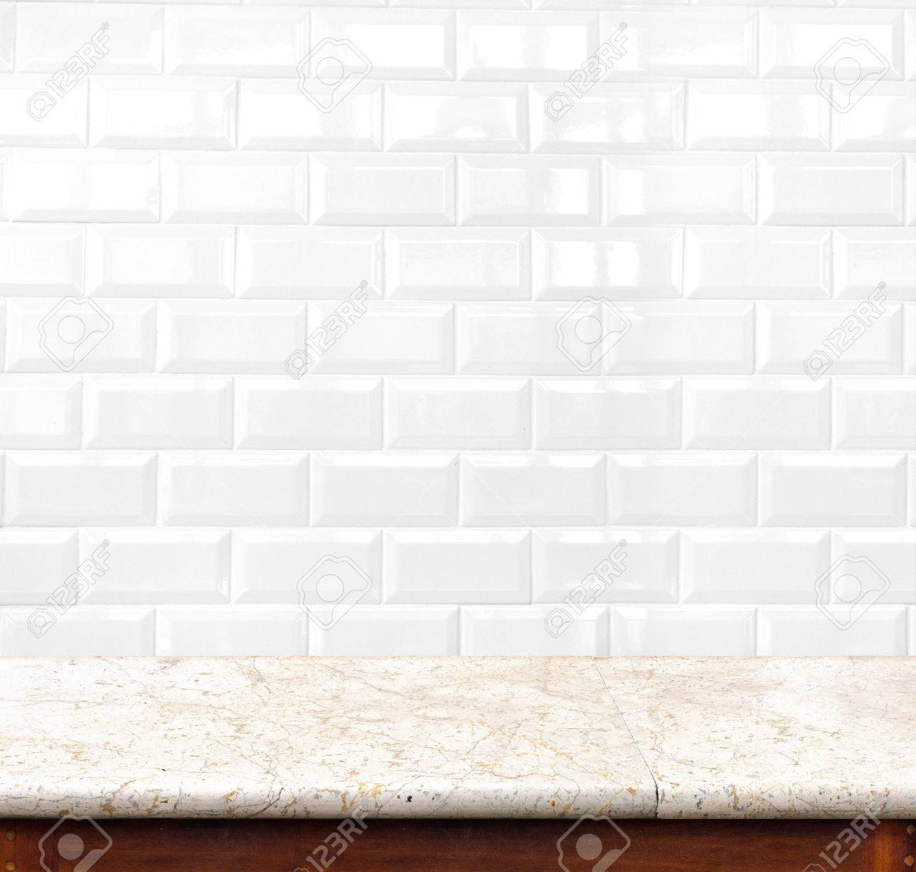 Empty marble table and ceramic tile brick wall in background empty marble table and ceramic tile brick wall in background product display template stock photo dailygadgetfo Gallery