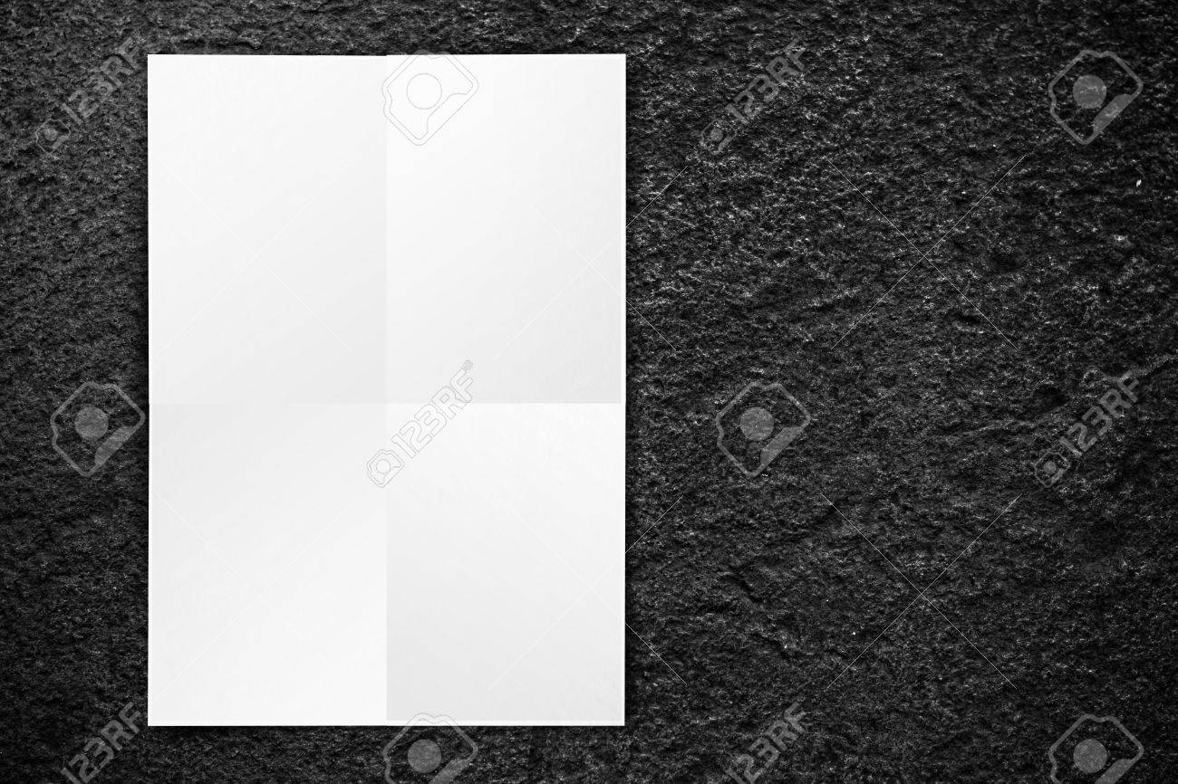 Black Folded White Paper Poster Hanging At Black Stone Wall – Free White Paper Templates