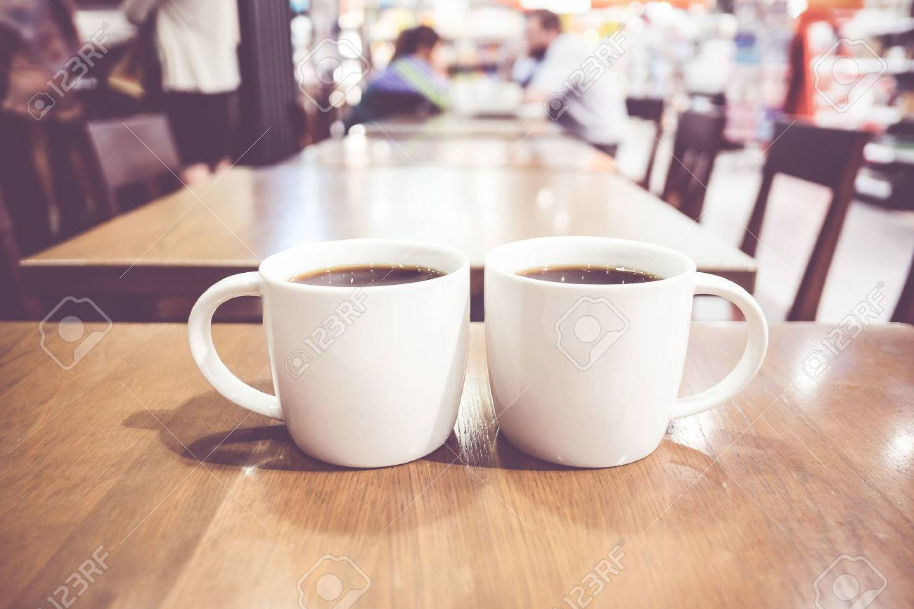 vintage filter couple of white coffee cup on wood table with