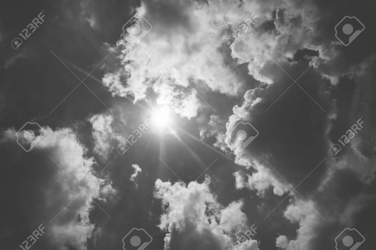Stock photo vintage filter nice blue sky with sun beam with cloudyblack and white color