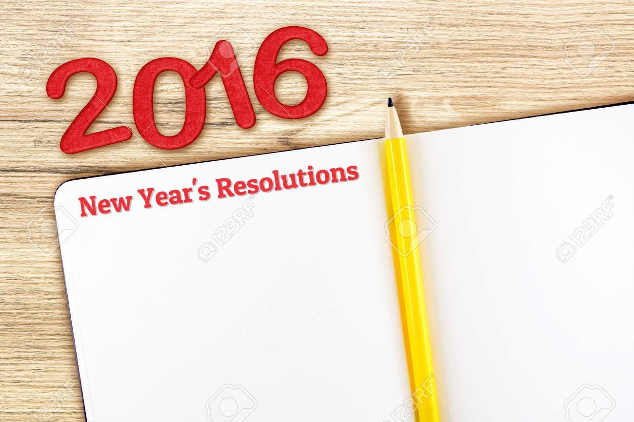 new years resolutions word on notebook lay on wood tabletemplate mock up for adding