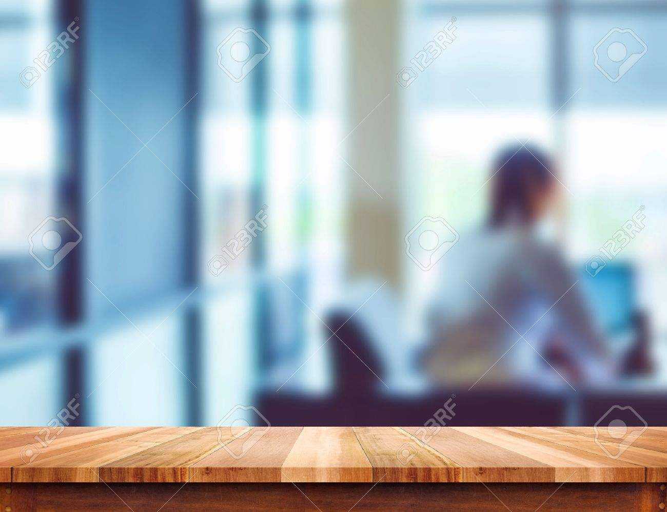 Empty wood table and blurred living room background stock photo - Empty Light Wood Table Top With Blur Office Background Leave Space For Placement You Content