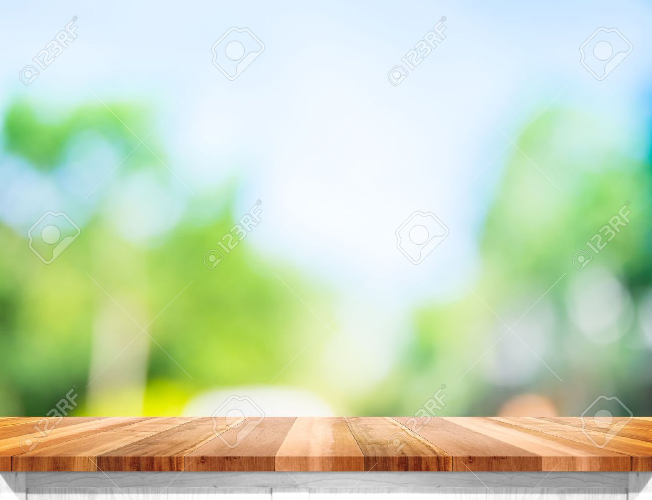 Empty brown wood table top with sun and blur green tree bokeh background, Template mock up for montage of product. - 53775524