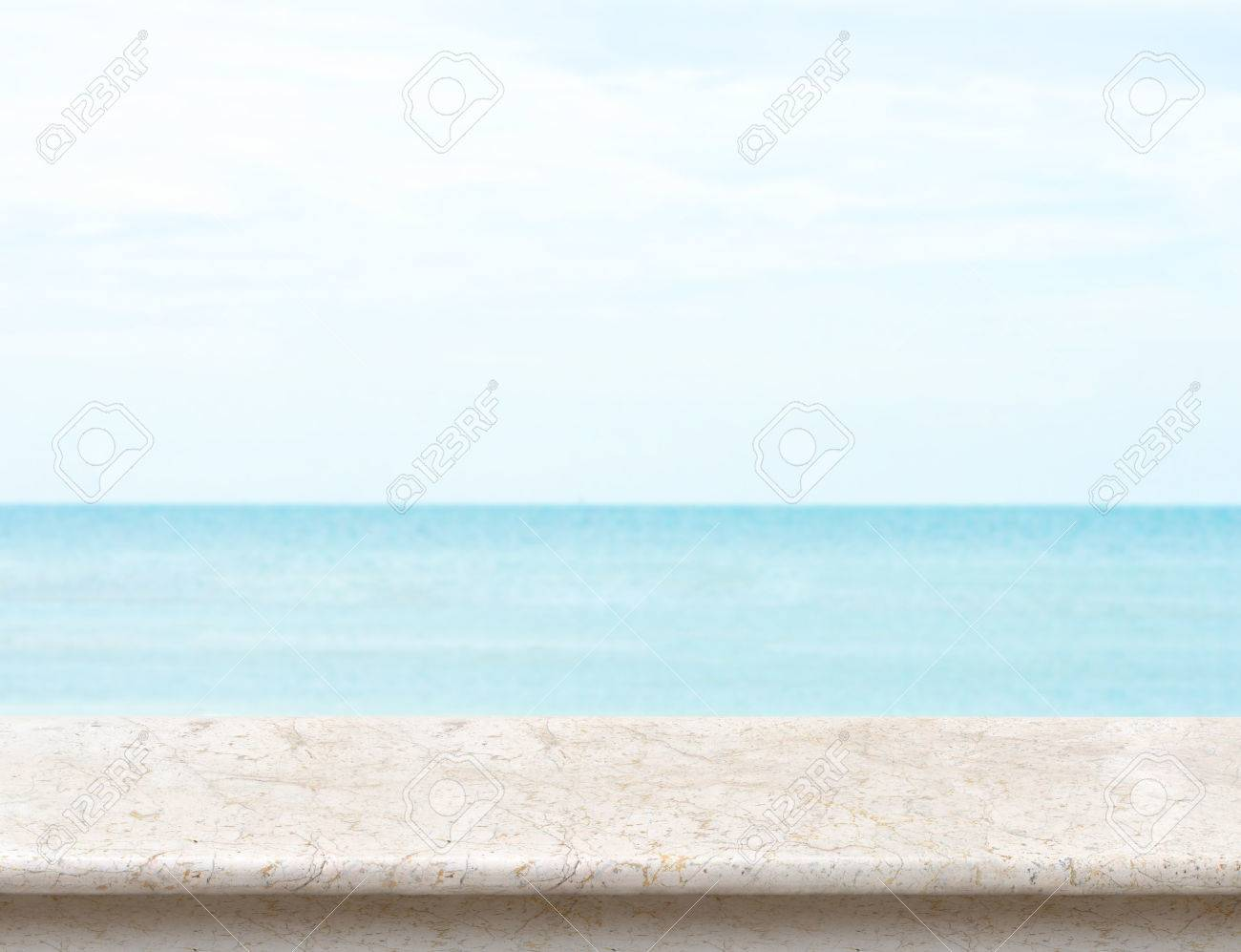 white marble table top. Stock Photo - White Marble Table Top With Blurred Sea And Blue Sky At Background, Mock Up Template For Display Or Montage Of Your Product, Summer Holiday D