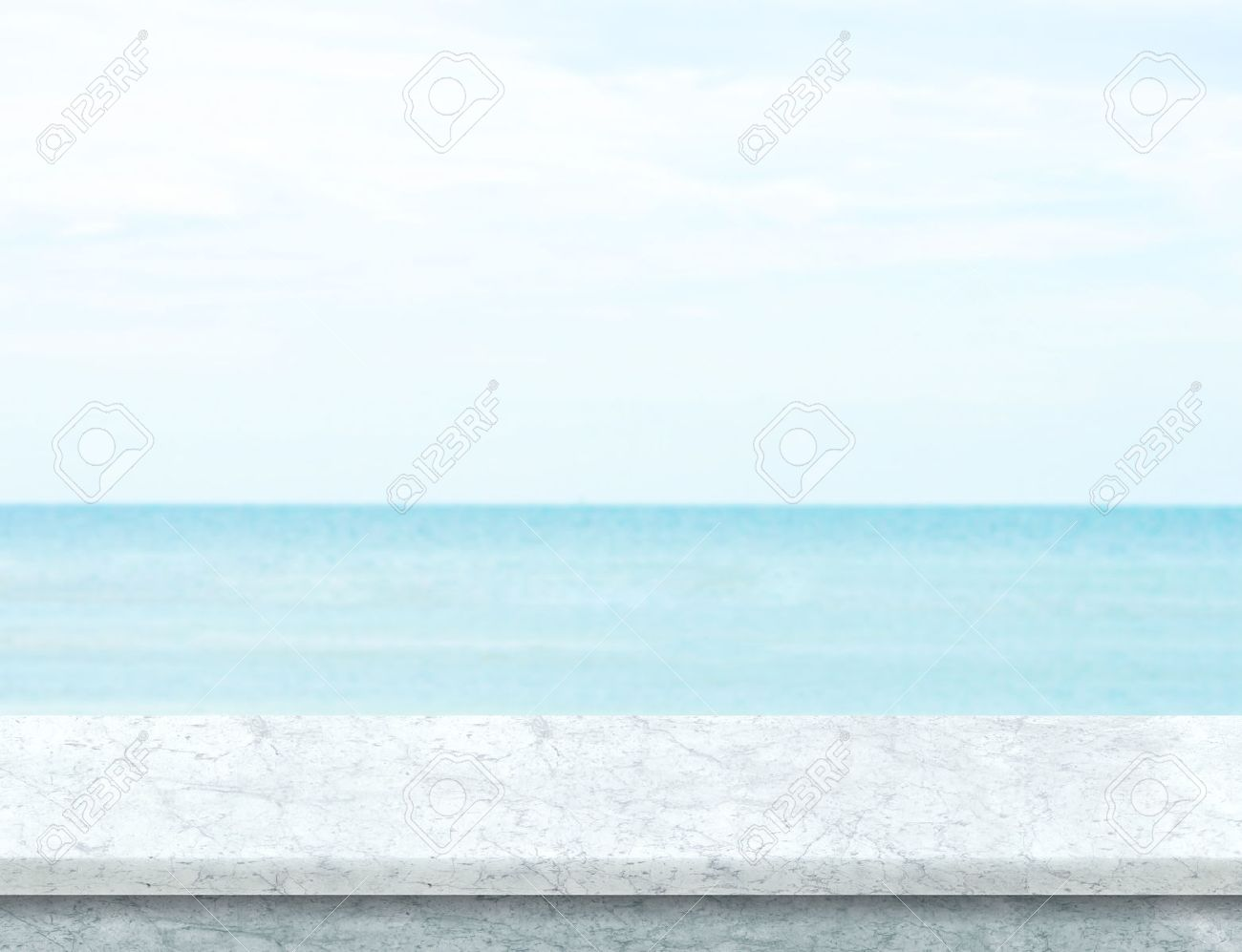 white marble table top. white marble table top with blurred sea and blue sky at background, mock up template t