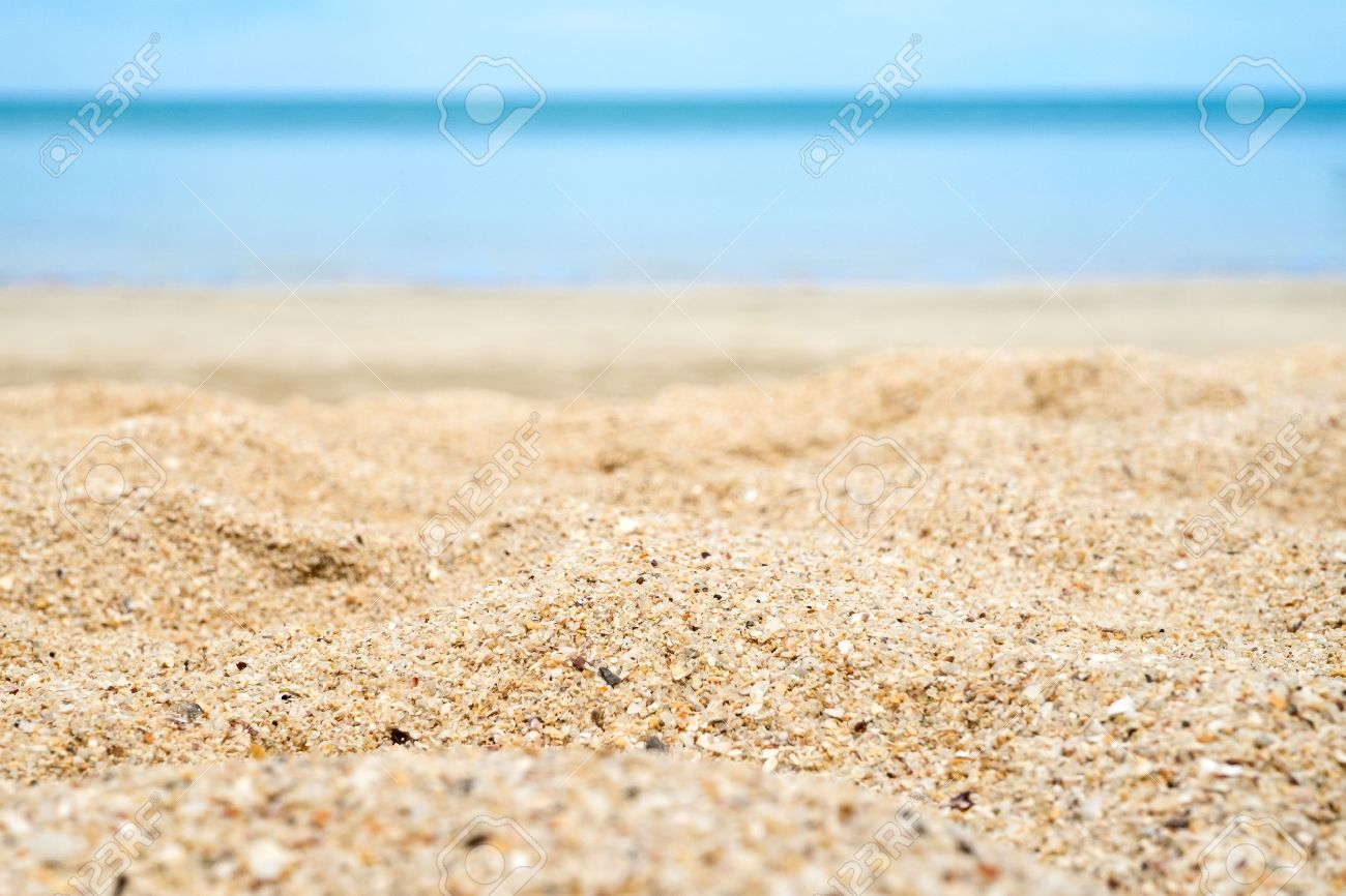 Close up beach sand with blur sea at background. - 60731386