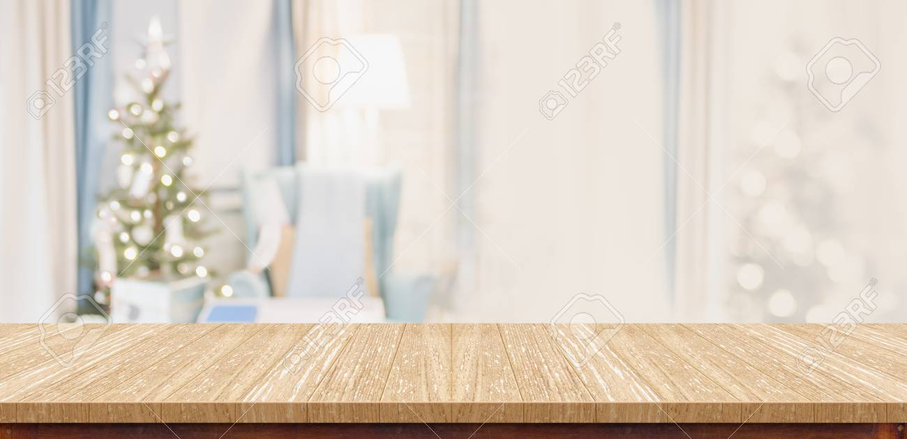Empty Wood Table Top With Abstract Warm Living Room Decor With Christmas  Tree Blur Background With